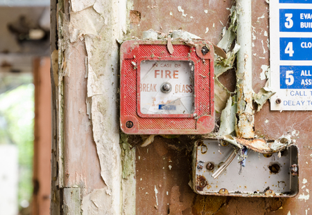 lancashire, England, 04042014, Whittingham Mental Asylum, An old abandoned smashed fire alarm button in an abandoned building. Exploring urban decay.