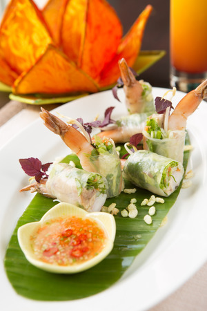 Fresh Vietnamese rice paper rolls, filled with chicken and shrimp and sided with a fish sauce. the name of the dish is  Goi Cuon Tom Ga. Vietnam cuisine. Stock Photo