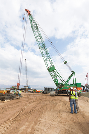 Aqaba, Jordan, 10102015, A tall crane working on the jetty foundation construction at the Aqaba new port