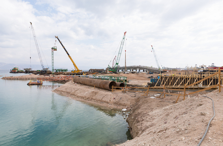 Aqaba, Jordan, 10102015, Cranes working on the foundation construction at the Aqaba new port