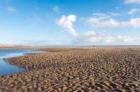 vanishing point: Beautiful blue sky and textured sand, on a cool sunny winters day at the beach