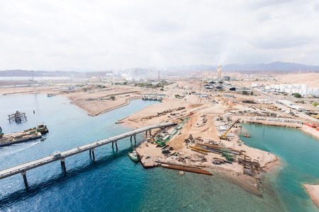 Aqaba, Jordan, 10102015, Metal and concrete Jetty foundation construction at the Aqaba new port photographed from above Редакционное