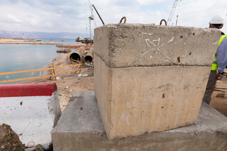 Concrete building block being used in the foundation construction at the Aqaba new port Фото со стока