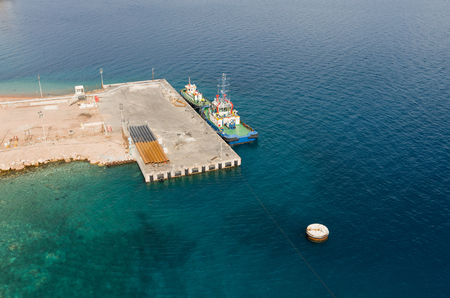 Aqaba, Jordan, 10102015, Metal and concrete Jetty foundation construction at the Aqaba new port photographed from above Editorial