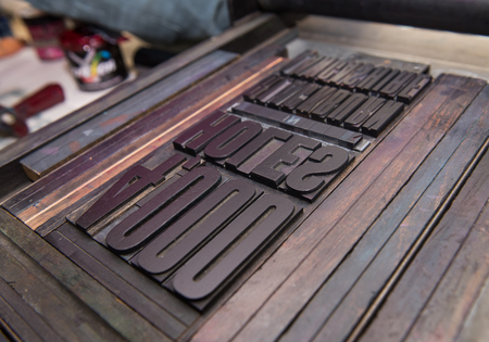 london, england, 05052017 vintage wooden antique analogue typeset letter blocks being prepared for block printing.