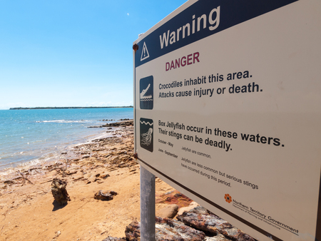 Darwin, Australia, 05052016, A beautiful summers day on a beach in darwin Australia. A No swimming sign on the beach due to crocodiles and box jellyfish in the sea.