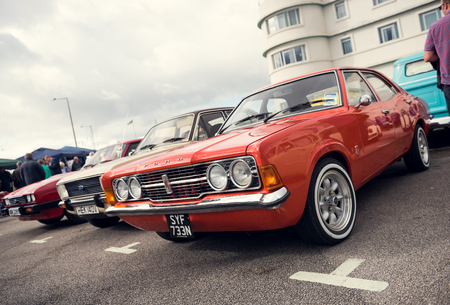 England, Morecambe, 08162016, Old retro ford escort car, at the Vintage by the sea weekend at the Midland Hotel in england, Retro vintage cars outside the midland hotel.