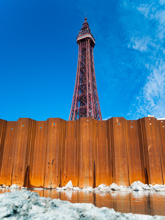 blackpool, england, 02022014, The world famous blackpool tower, against a vibrant blue summer sky background. Comedy carpet installation building works.