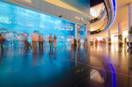dubai, united arab emirates, 05052017 Dubai mall in dubai, the largest fish tank aquarium in the world shot with a slow shutter speed with motion blur on the crowd.