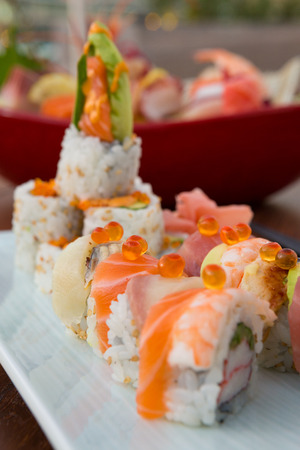 Fish egg and raw salmon sushi japanese food, served on a white clean plate with a shallow depth of field bokeh. Stock Photo