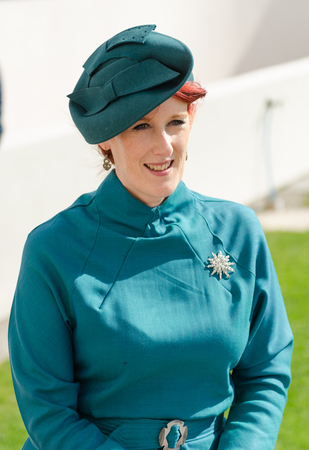 london, England, 05052017, A stylish retro vintage fashionable woman with red hair, 1940s blue clothing, and a silver broach in a Best dressed award at a vintage event..