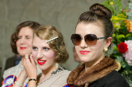 london, England, 05052017, A stylish retro vintage fashionable group of young girls, in a Best dressed award at a vintage event..