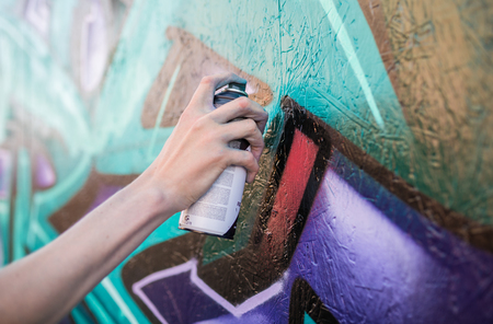 ulverston, England, 0505201, A graffiti artist working at a public exhibition of legal graffiti and street art. Art in the town of ulverston. A live graffiti wall been spray painted. Editorial
