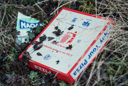 london, engalnd, 05052017, Street litter fly tipping on the streets. Food waste and non recyclable food and product waste packaging discarded in urban areas.