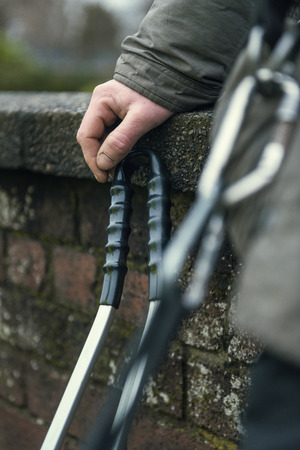 A community worker, a litter pickers hand holding onto a litter grabber. Shot with a shallow depth of field. Stock Photo