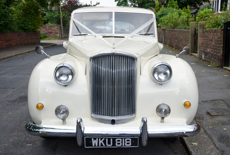 london, england, 05082016, A beautiful vintage retro immaculate rolls royce phantom princess motor vehicle, waiting to pick up a bride and take her to a wedding. Exclusive luxury wedding travel. Editöryel