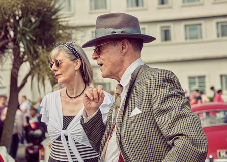 morecambe, England, 05052017, A group of stylish retro vintage fashionable men and women acting and posing in fancy dress cosplay in a Best dressed award at a vintage event at the Midland hotel.