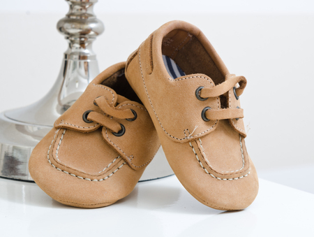 Baby leather shoes on a white background
