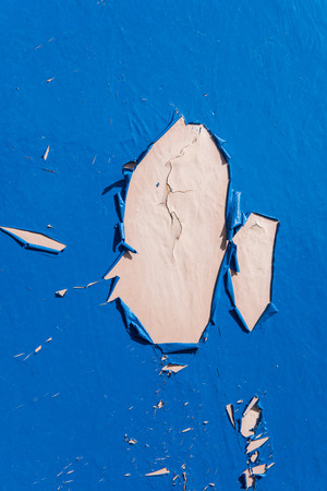 Blue dry peeling crackling chipped paint textured wall