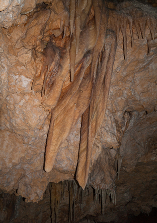 big stalactites hanging from a cave ceiling Stock Photo
