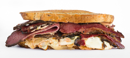 Smoked meat beef sandwich with mustard, cheese, onion and black pepper corns, isolated on white