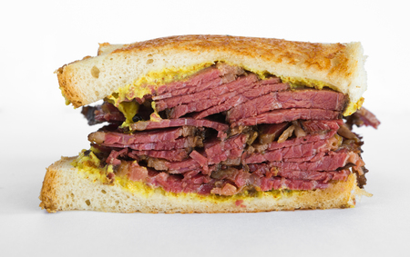 Smoked meat beef sandwich with mustard and black pepper corns, isolated on white