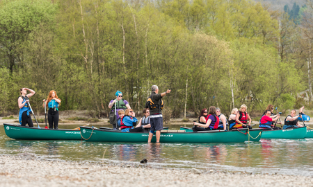 Lake Coniston, England, 06062016, A group of canoeists, canoeing on Lake Coniston, The Lake District. Team building exercise.