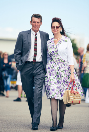 london, England, 05052017, A stylish retro vintage teddy boy elvis style 1950s fashionable man with a quiff with a woman walking at a vintage event..
