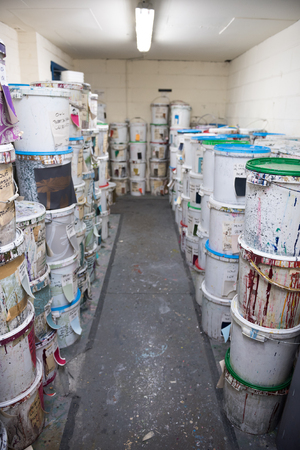 Industrial fabric and wallpaper dye ink paint, in plastic buckets. Fabric dye is used in creating colour for the clothing and textile industry. fashion industry. Muted colours.