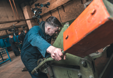london, england, 02022018, Young industrial metal working apprentice workers learning various metal working skills in an industrial factory setting. Apprentice schemes returning to england.