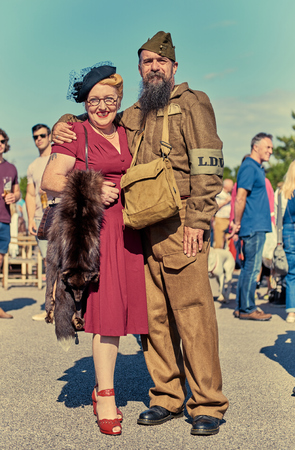 london, England, 05/05/2017, A stylish retro vintage fashionable portrait of a world war soldier with a long beard and green beret at a vintage event..