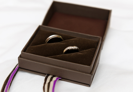 Wedding rings in a black ring box, soft with a beautiful creamy shallow depth of field. Wedding rings.