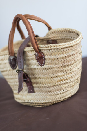 A light hand crafted hippy wicker weaved and woven carrying bag. Eco friendly made with sustainable reusable recycled products. Leather handles.