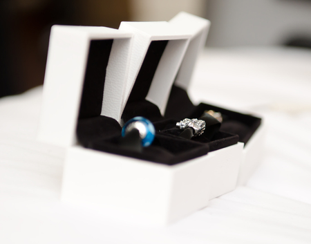 Wedding jewellery on a white soft surface, in white boxes , soft with a beautiful creamy shallow depth of field.
