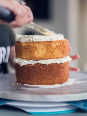 A beautiful organic delicious orange warm baked sponge cake, with fresh cream inside. cream icing baster.