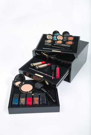 london, england, 05052017 A gucci cosmetic, makeup fashion variety box. cosmetic and beauty industry makeup box. on a white isolated background. mascara, lipstick and foundation. Editorial