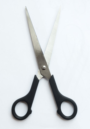 A pair of sharp metal cutting scissors with the cutting blades open. scissors for craft isolated against a white background. Black handle. Stock fotó