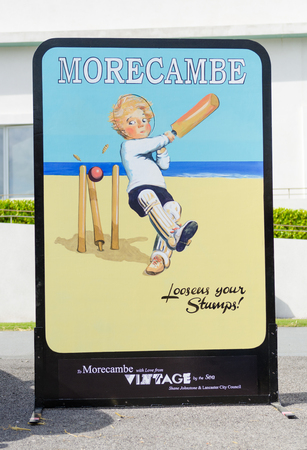 morecambe, england, 05052018 Retro wooden cutout head hole wooden retro fairground seaside feature in morecambe by the sea. cricket memorabilia.