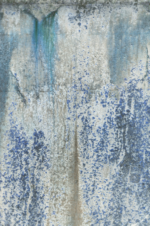 A rustic rough industrial raw concrete textured wall. Blue algae and gritty dirt.