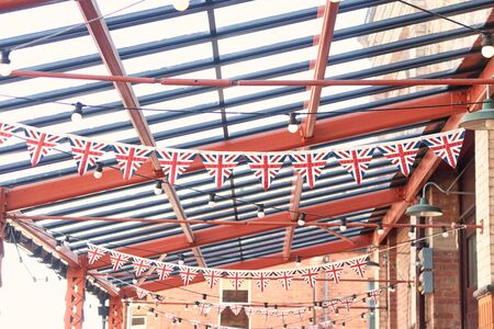 British union jack bunting , celebrating jubilee queens day. England pride, patriotic, vintage wartime english triangle bunting. Graphic flag symbolism.