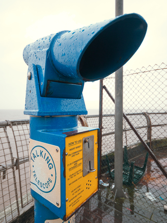 England, Blackpool, 04222015, Retro blue telescope on the end of north pier in blackpool. run down seaside objects. Editorial