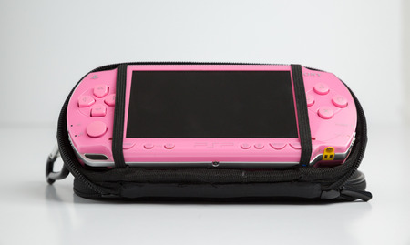 london, england, 05052019 A pink sony playstation psp portable games console. pop 1001. Rare pink edition with blank screen isolated on a white background. retro vintage gamers computer console.