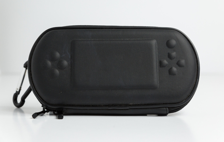 A black sony playstation psp portable games console carry case. retro vintage gamers computer console accessories.