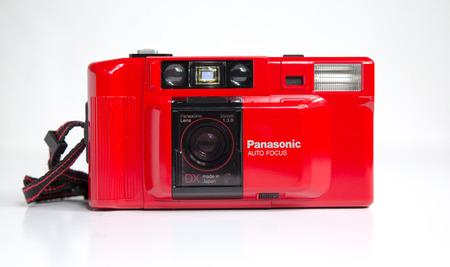 london, england, 05/05/2019  a retro vintage red PANASONIC C-500 AF DX 35mm FILM CAMERA RARE PANASONIC FILM CAMERA old photographic technology analogue. hipster trendy
