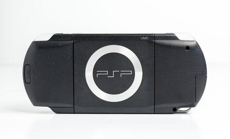 london, england, 05052019 A black sony playstation psp portable games console. psp 1000. glossy black edition with blank screen isolated on a white background. retro vintage gamers computer console.