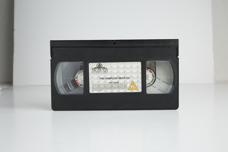 london, england, 05052018 The Beatles Old retro vhs tape  isolated on a white background. nostalgic 1980s music video.
