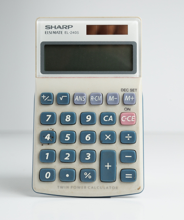 london, england, 05052018 A retro solar powered vintage solar powered calculator. 1980s technology for school maths and accounting. nostalgic equipment with analog rubber buttons Redactioneel