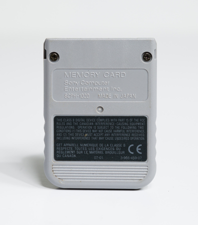 london, england, 050852019, official sony playstation memory card isolated on a white seamless background. Saving computer games and data. small vintage memory card for console computer games.