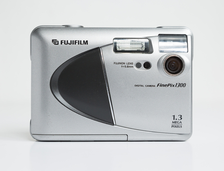 london, england, 05052019 fujifilm finepix 1300 1.3 mega pixel digital camera. a very early digital camera with built in flash and thin floppy disc memory card. fuji are big players in the digital camera market. hipster photography