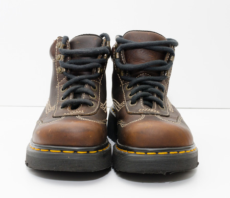 london, englan,. 05052019 Dr Martens Ankle Boots Brown Wing Tip 9234 made in england. iconic punk british hard leather footwear. hiking and workwear boots isolated.